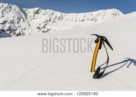 Ice Axe Stuck In The Snow On The Slopes.