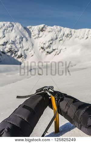 Mittens Clipped Carabiner On A Yellow Ice Axe.