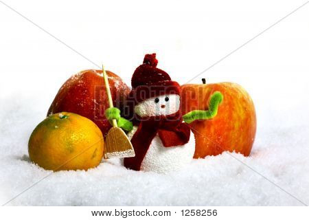Snowman And Apples In Snow