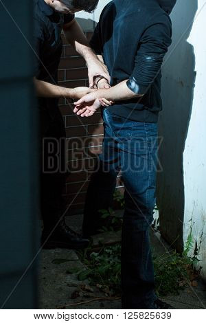 Policeman Handcuffing Man
