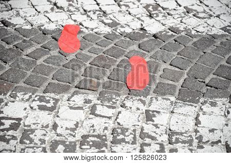 Red Footsteps In Town