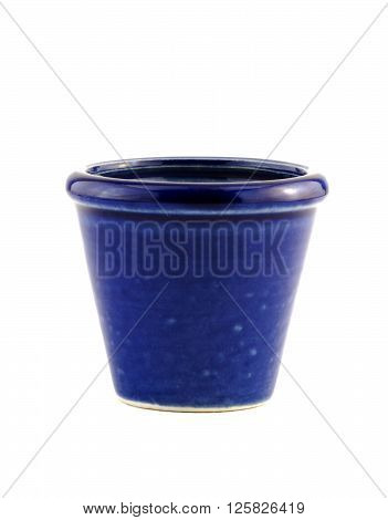 Isolated on white an empty blue ceramic garden plant pot