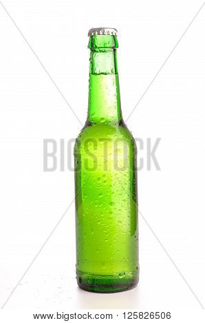 Cold bottle of beer on a white background