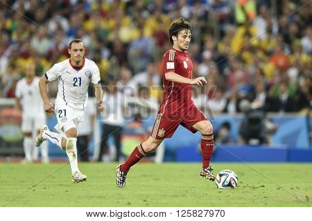 RIO DE JANEIRO BRAZIL - June 18 2014: David SILVA of Spain during the 2014 World Cup. Spain is facing Chile in the Group B at Maracana Stadium