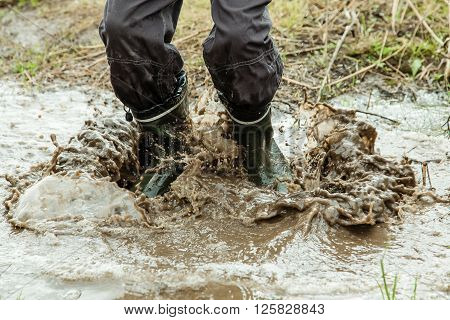 Unidentifiable Person Jumping In Muddy Water