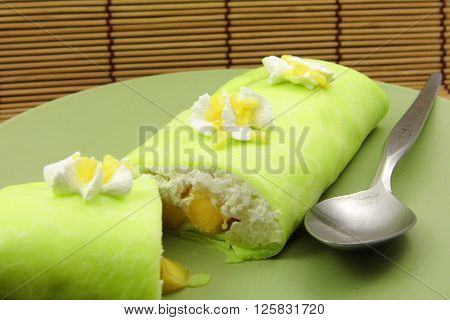 Sticky rice and mango crepe cake roll pandan flavor, Thai food style in summer
