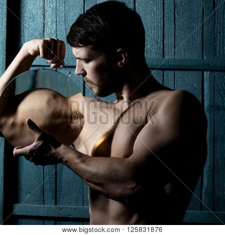 Muscular Man With Loupe