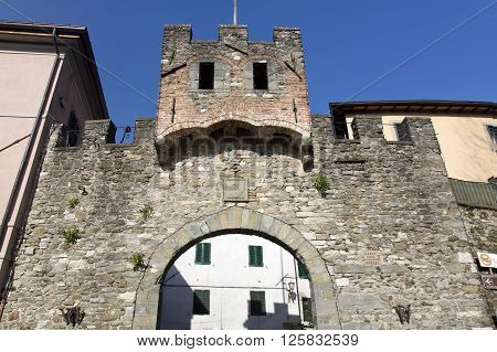 Entrance gate of the medieval town Barga in Lucca province Tuscany Italy