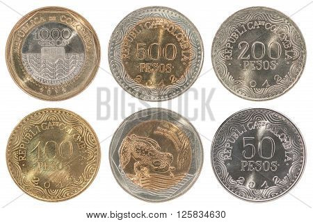 A complete set of new Colombian coins isolated on white background