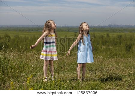 Two Girls Are Pretty Children In Nature Happily Smiling In The Sunshine
