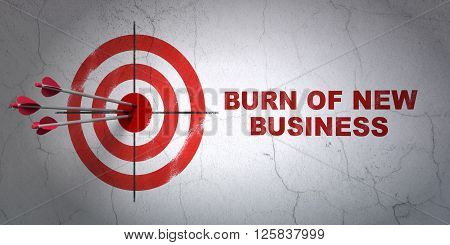 Business concept: target and Burn Of new Business on wall background