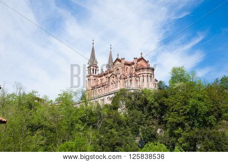 landmark behind view of ancient basilica church Santa Maria La Real of Covadonga from year 1901 in Cangas de Onis one of the most important monuments in Asturias Spain Europe