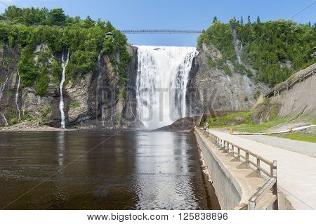 BEAUPORT QUEBEC/CANADA - JUNE 14 2010: Violent drop at Montmorency Falls turns into peaceful eddy