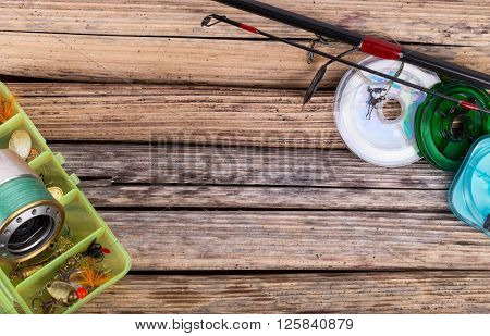 Fishing Tackles On Background Of Dry Stems