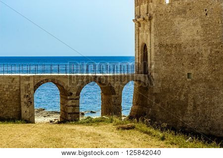 Entrance of medieval Maniace's Castle in Siracusa