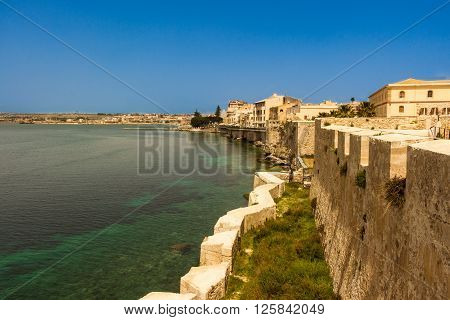 The city of Siracusa in Sicily blue bay.