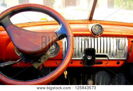Vintage car interior view parked on the street in Havana, Cuba.