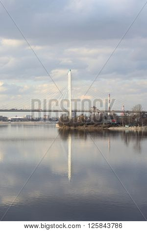 Cable stayed bridge and Neva river on the outskirts of St. Petersburg at cloud spring day Russia.