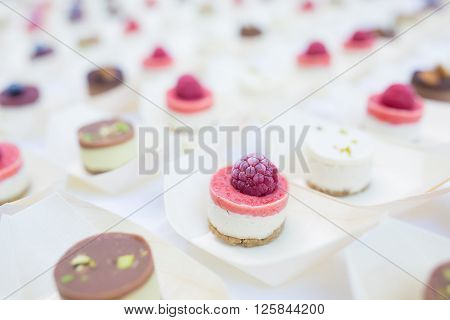 closeup small raw raspberry pink creme cookie ** Note: Visible grain at 100%, best at smaller sizes