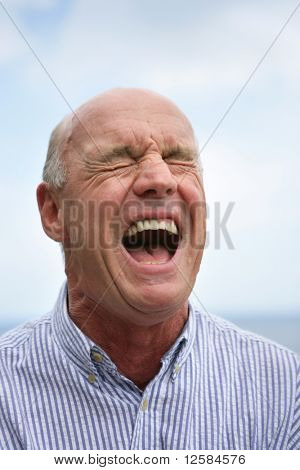 Portrait of a senior man screaming