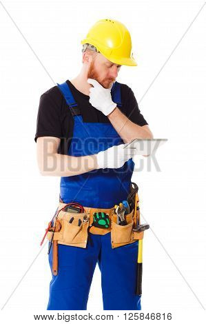 Man builder with belt of different construction tools isolated