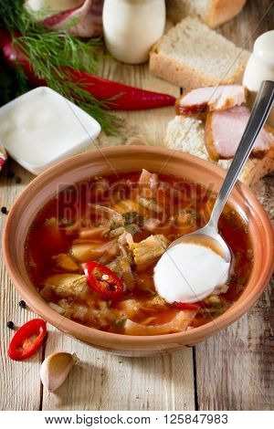 Vegetable Soup With Beetroot (borscht) On A Wooden Table, The National Dish Of Traditional Russian A