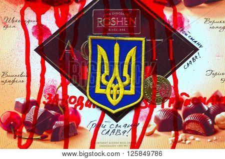 ILLUSTRATIVE EDITORIAL.Chevron of Ukrainian nazionalist battalion. With logo Roshen Inc. Trademark Roshen is property of Ukrainian president Poroshenko.At April 15,2016 in Kiev, Ukraine