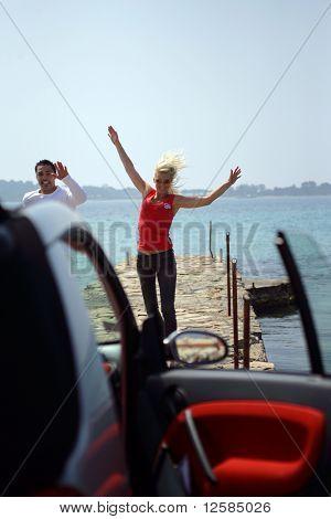 Smiling couple on a pontoon