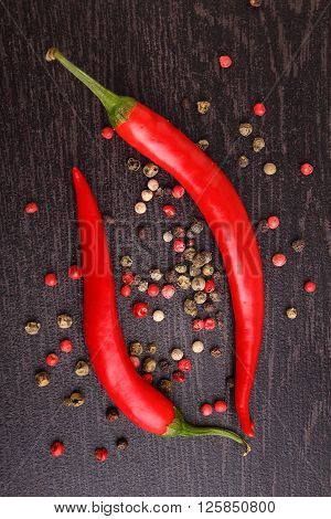 red pepper pepper rosemary on a black background