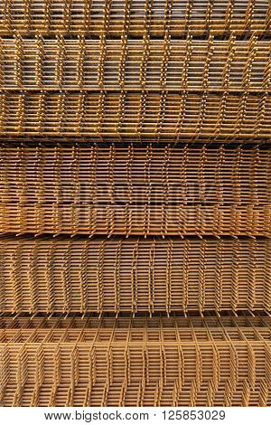 Rusty stacked steel wire fabric in vertical format