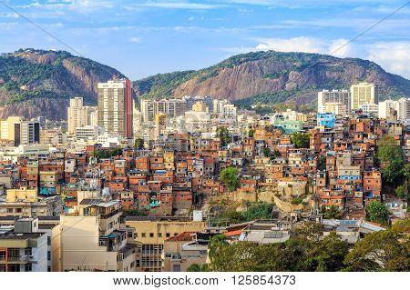 Rio de Janeiro downtown and favela with blue sky