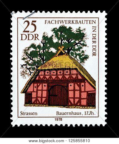 GERMAN DEMOCRATIC REPUBLIC - CIRCA 1978 : Cancelled postage stamp printed by German Democratic Republic, that shows Farmhouse.