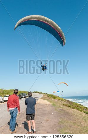 PORT ELIZABETH SOUTH AFRICA - FEBRUARY 27 2016: A paraglider in the air at Beachview near Port Elizabeth
