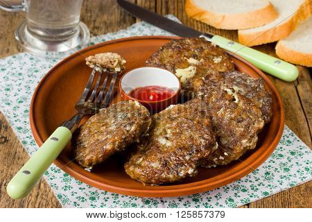 Cutlets from the liver. Hepatic fritters. Food increases hemoglobin. Selective focus