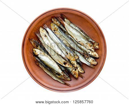 Smoked sprats on plate top view isolated on the white background