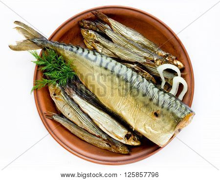 Smoked sprats and mackerel fish on plate top view isolated on the white background