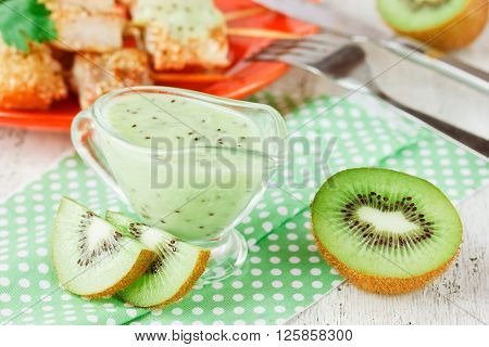 Low-calorie sauce of kiwi to the fish and meat selective focus