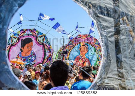 Sumpango, Guatemala - November 1 2015: View through opening in giant kite of visitors & kites at giant kite festival on All Saints' Day to honor spirits of dead.