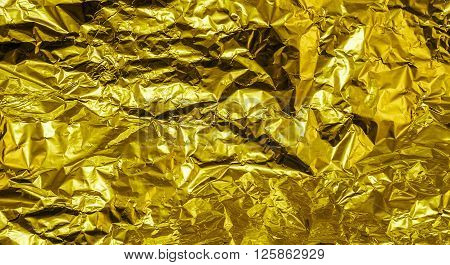 Gold Crumpled Aluminum Foil Texture Background High Contrasted