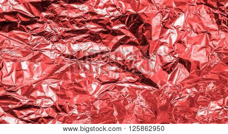 Red Crumpled Aluminum Foil Texture Background High Contrasted