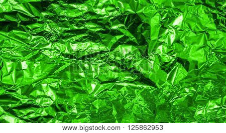 Green Crumpled Aluminum Foil Texture Background High Contrasted