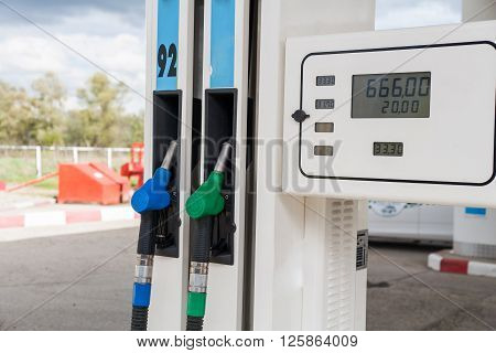 Petrol-station. Two gas pumps of green and blue colors