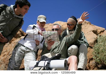 Group of hikers observing a plan