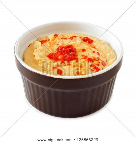 Spicy Hummus Dip A With Hot Peppers In A Ramekin Bowl Isolated On A White Background
