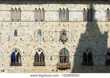 Facade of the palace of old people (Palazzo degli Anziani o di Giano) Town Hall of Pistoia Tuscany Italy - XIII - XIV century