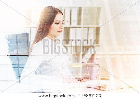 Businesswoman working on laptop office at background. Double exposure. Concept of work.