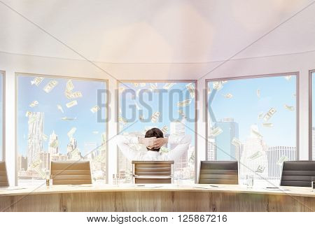Businessman sitting in conference room with hands on head. Large windows with money rain view. 3D Rendering