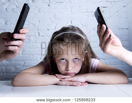 hands of internet and network addict mother and father using mobile phone neglecting little sad ignored daughter bored and lonely feeling abandoned and disappointed in parents bad behaviour concept