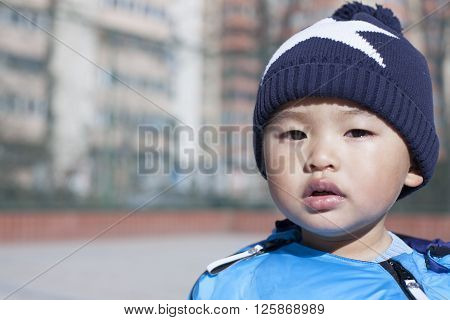 Portrait of a Chinese baby boy shot in Beijing China