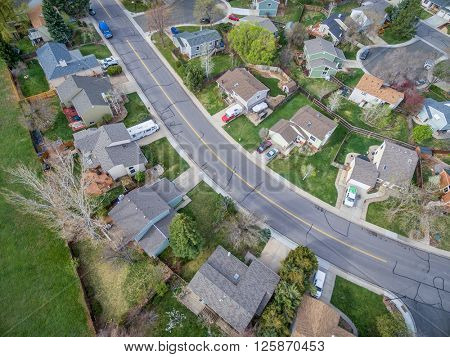 FORT COLLINS, CO, USA - APRIL 15, 2016: Aerial  view of typical residential neighborhood along Front Range of Rocky Mountains in Colorado in early spring (mid April)